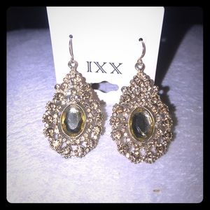 Gold formal earrings with crystal scroll design